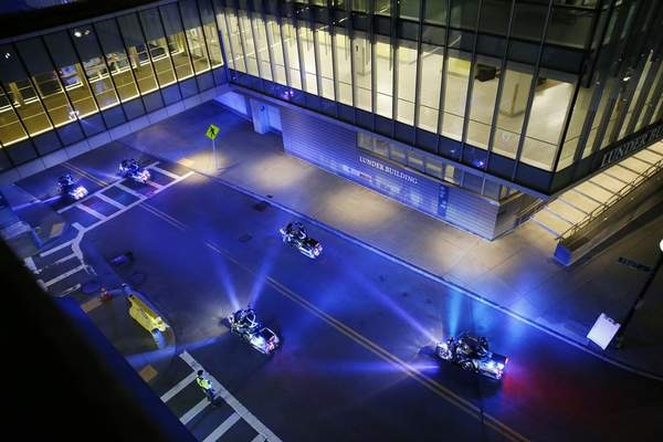 A police motorcade for the ambulance carrying David Ortiz arrives at Mass General Hospital in Boston after being flown from the Dominican Republic, Monday night, June 10, 2019. Ortiz is back in Boston for medical care, a day after authorities said the former Red Sox slugger affectionately known as Big Papi was ambushed by a gunman at a bar in his native Dominican Republic. (Jessica Rinaldi/The Boston Globe via AP)