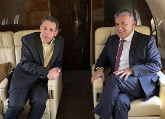 This photo released on the official twitter page of the Lebanese General Security Directorate, shows Maj. Gen. Abbas Ibrahim, right, chief of Lebanese General Security Directorate, and Nizar Zakka, left, a Lebanese citizen and permanent U.S. resident who was released in Tehran after nearly four years in jail, aboard the flight from Iran to Lebanon, Tuesday, June 11, 2019. (The official twitter page of the Lebanese General Security Directorate via AP)