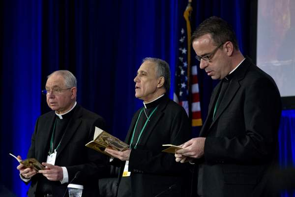 Associated Press From left, Archbishop Jose Gomez,  Cardinal Daniel DiNardo and Rev. J. Brian Bransfield participate in a morning prayer in Baltimore on Tuesday.