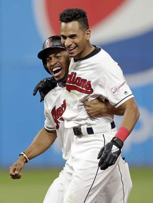 Associated Press The Indians' Oscar Mercado, right, celebrates with Francisco Lindor after hitting a game-winning single Tuesday in Cleveland.
