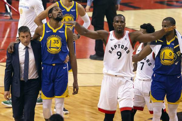 Associated Press  Golden State star Kevin Durant walks off the court Monday night after injuring his Achilles in the first half of Game 5 of the NBA Finals in Toronto.