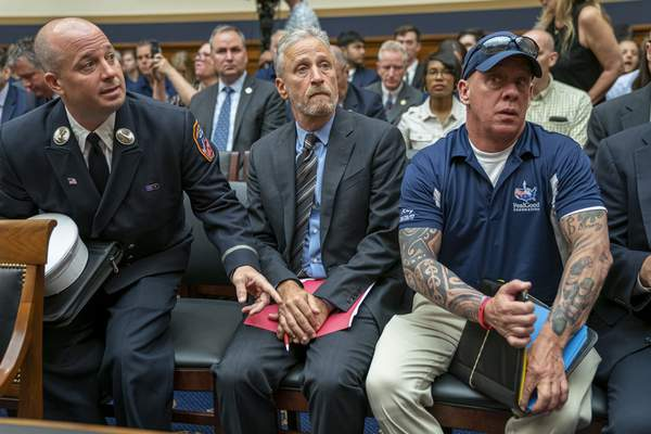 Associated Press Entertainer and activist Jon Stewart joins firefighters, first responders and survivors of the Sept. 11 terror attacks Tuesday at a hearing of the House Judiciary Committee on the future of the Victim Compensation Fund.