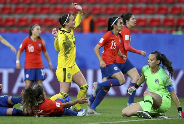 Associated Press Sweden's Kosovare Asllani, in yellow, celebrates after scoringthe opening goal Tuesday against Chile in Rennes, France.