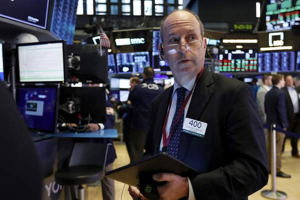 Associated Press Trader Gordon Charlop works on the floor of the New York Stock Exchange on Tuesday.