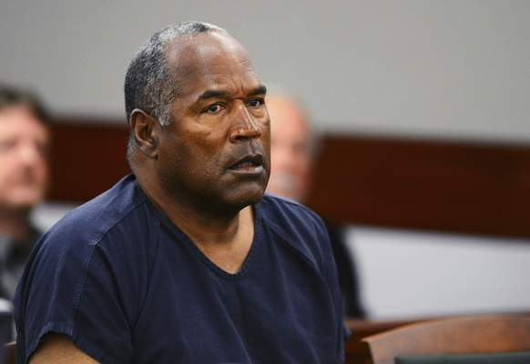 FILE - In this May 14, 2013, file photo, O.J. Simpson appears at an evidentiary hearing in Clark County District Court in Las Vegas. (Ethan Miller via AP, Pool, File)