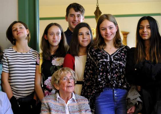 Jacqueline van Maarsen, center, poses for a photo with students from the International School of Amsterdam during an event to mark what would have been Anne Frank's 90th birthday, in Amsterdam on Wednesday, June 12, 2019. (AP Photo/Michael C. Corder)
