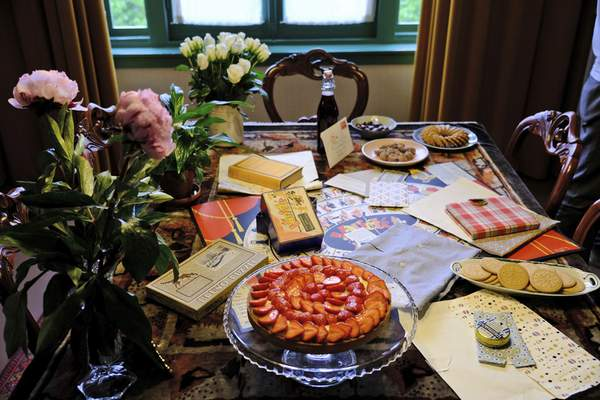 A table is decorated with replicas of gifts Anne Frank received for her 13th birthday– including her first diary– during an event at her family's former apartment in Amsterdam to mark what would have been the teenage Jewish diarist's 90th birthday June 12, 2019. (AP Photo/Michael C. Corder)