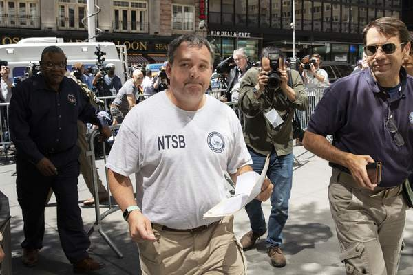 Doug Brazy, an investigator with the National Transportation Safety Board, leaves a news conference, Tuesday, June 11, 2019 in New York. He gave an update on Monday's helicopter crash on the roof of a rain-shrouded Manhattan skyscraper, killing the pilot, Tim McCormack, of Clinton Corners, N.Y. (AP Photo/Mark Lennihan)