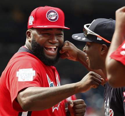 FILE - In this July 15, 2018, file photo, World Team Manager David Ortiz (34) speaks with U.S. Team Manager Torrii Hunter, before the All-Star Futures baseball game at Nationals Park, in Washington. (AP Photo/Alex Brandon, File)