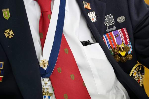 A row of medals, including four Purple Hearts and three Silver Stars, are worn by D-Day survivor Ray Lambert during a reception at the American Military Cemetery in Colleville-sur-Mer, France, on Thursday, June 6, 2019. (AP Photo/Allen G. Breed)