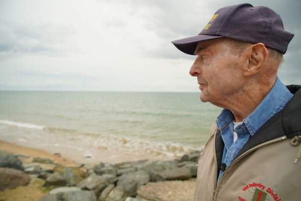 D-Day survivor Ray Lambert looks out over Omaha Beach in Colleville-sur-Mer, France, on Wednesday, June 5, 2019. (AP Photo/Allen G. Breed)