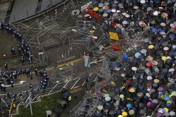 Protesters gather outside the Legislative Council in Hong Kong, Wednesday, June 12, 2019. (AP Photo/Vincent Yu)