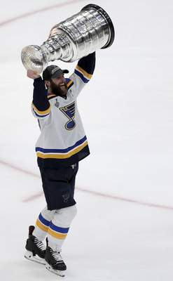 Associated Press The Blues' Alex Pietrangelo carries the Stanley Cup on Wednesday  after defeating the Bruins in Boston.