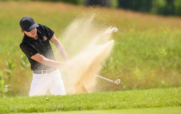 Doug McSchooler   Special to The Journal Gazette Warsaw freshman Cal Hoskins hits out of a sand  trap Wednesday at Prairie View Golf Club. Hoskins finished with the lowest score among area players, shooting a 156 over two rounds.