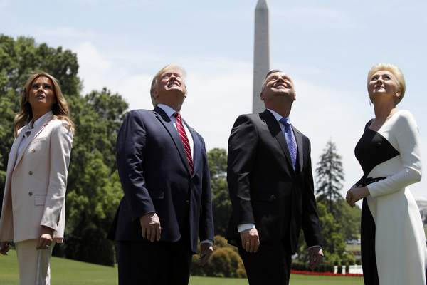 Associated Press  President Donald Trump and first lady Melania Trump watch a flyover with Polish President Andrzej Duda and wife Agata Kornhauser-Duda.