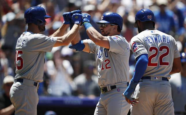 Associated Press  Cubs pitcher Cole Hamels, left, congratulates Kyle Schwarber as he crosses home plate after connecting for a three-run home run in the second inning Wednesday in Denver.