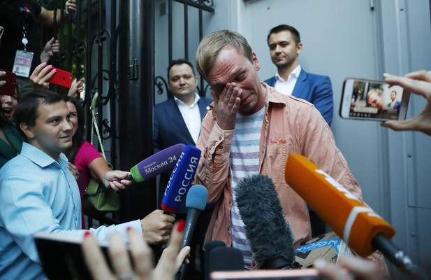 Prominent Russian investigative journalist Ivan Golunov, cries as he leaves a Investigative Committee building in Moscow, Russia, Tuesday, June 11, 2019. (AP Photo/Pavel Golovkin)