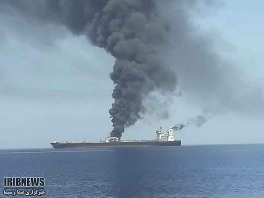 In this photo released by state-run IRIB News Agency, an oil tanker is on fire in the sea of Oman, Thursday, June 13, 2019. Two oil tankers near the strategic Strait of Hormuz have been reportedly attacked. (IRIB News Agency via AP)
