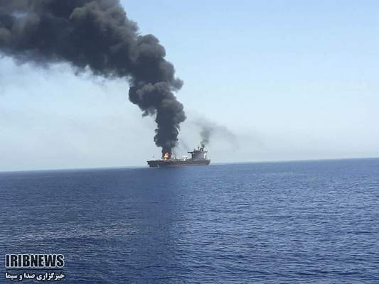 In this photo released by state-run IRIB News Agency, an oil tanker is on fire in the sea of Oman, Thursday, June 13, 2019. (IRIB News Agency via AP)