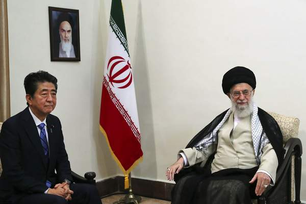 In this picture released by an official website of the office of the Iranian supreme leader, Supreme Leader Ayatollah Ali Khamenei, right, meets with Japanese Prime Minister Shinzo Abe, in Tehran, Iran, Thursday, June 13, 2019. (Office of the Iranian Supreme Leader via AP)