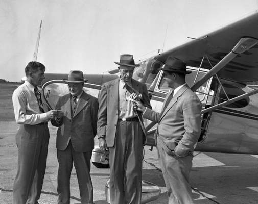 May 22, 1948: Pilot James Groseclose, right, presents a Certificate of First Flight to his 82-year-old grandfather, Lew L. DeHaven. Marcy P. Gettle, left, president of Airgo Division of Consolidated Aircraft, which sponsored the flight, gives one to William A. Bayer. (Journal Gazette file)
