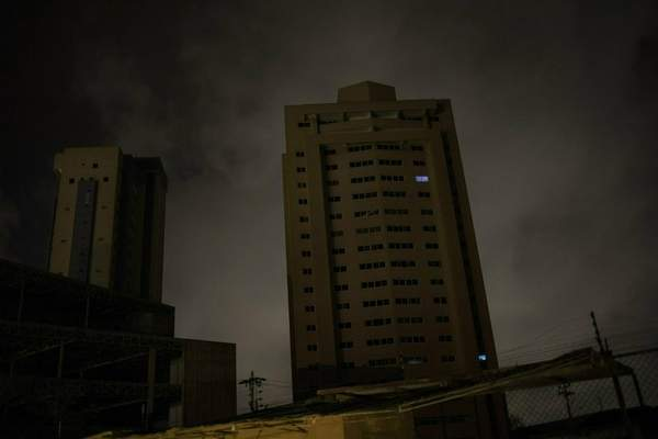 In this May 23, 2019 photo, only two apartments of a building are illuminated by electric generators during a blackout in Maracaibo, Venezuela. (AP Photo/Rodrigo Abd)