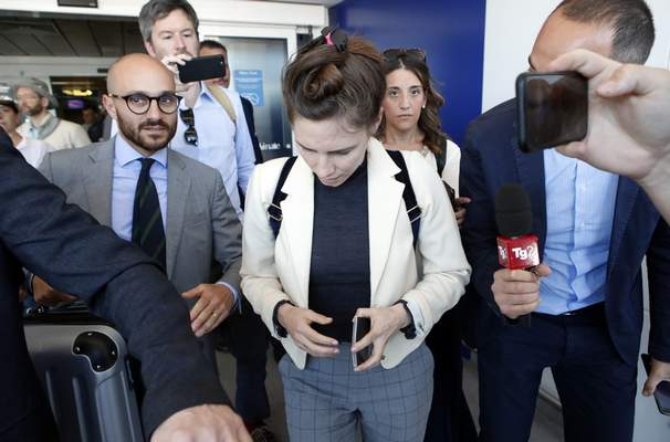 Amanda Knox, center, is approached by journalists upon her arrival in Linate airport, Milan, Italy, Thursday, June 13, 2019. (AP Photo/Antonio Calanni)