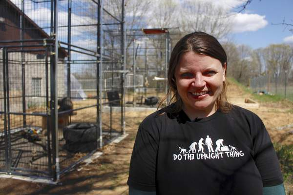 In this May 13, 2019, photo, Amy Kerwin stands outside the outdoor enclosures at Primates Inc., in Westfield, Wis. (AP Photo/Carrie Antlfinger)