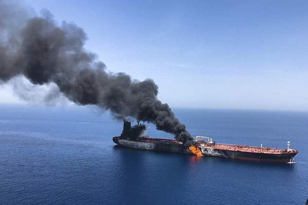Associated Press An oil tanker is seen on fire Thursday in the sea of Oman. Two oil tankers near the strategic Strait of Hormuz were reportedly attacked, an assault that left one ablaze and adrift as sailors were evacuated from both vessels.