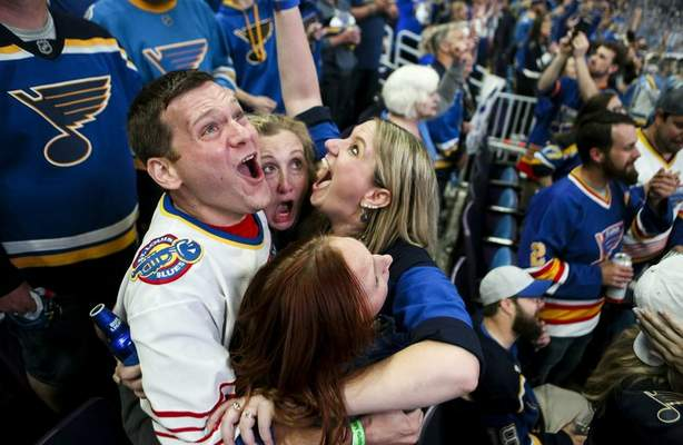 Associated Press Bill Kess, left, and his friends react during a watch party in St. Louis as the Blues win the Stanley Cup on Wednesday in Boston.