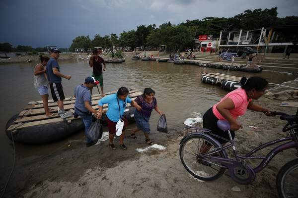 Associated Press Passengers disembark Wednesday from a raft in Tecun Uman, Guatemala, after crossing the Suchiate River from Mexico. Illegal crossings are common for work and shopping in the area.
