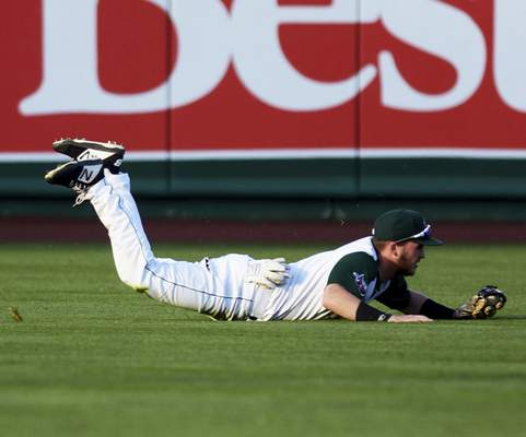 Katie Fyfe   The Journal Gazette TinCaps outfielder Grant Little makes a diving catch during the fourth inning of Friday night's game at Parkview Field against the Lake County Captains.