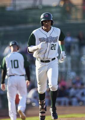 Katie Fyfe   The Journal Gazette  TinCaps outfielder Agustin Ruizrounds the basesafter hitting a home run during the first inning of Fort Wayne's 3-2 win over Lake County on Friday. It was Ruiz's second home run of the season.
