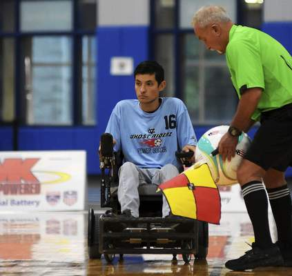 Katie Fyfe | The Journal Gazette  Team Ghost Riderz' Daniel Cornejo prepares to hit the ball back in during the 2019 Power Soccer Conference Cup Series at Turnstone Center for Children and Adults with Disabilities on Saturday.