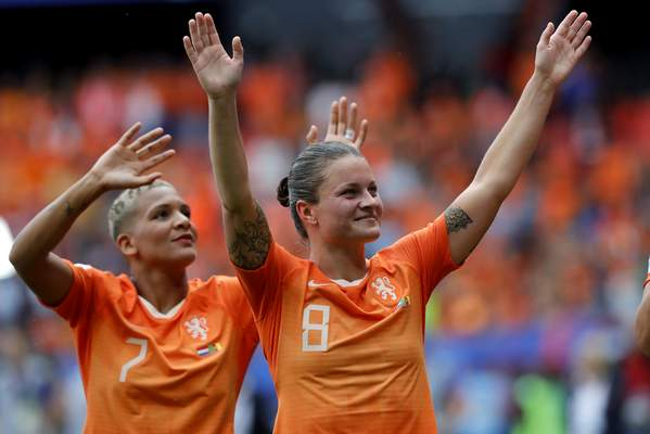 Netherlands' Shanice Van De Sanden, left, and Netherlands' Sherida Spitse, right, celebrate after the Women's World Cup Group E soccer match between the Netherlands and Cameroon at the Stade du Hainaut in Valenciennes, France, Saturday, June 15, 2019. The Netherlands defeated Cameroon by 3-1. (AP Photo/Michel Spingler)