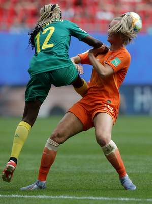 Cameroon's Claudine Meffometou, left, and Netherlands' Jill Roord, right, challenge for the ball during the Women's World Cup Group E soccer match between the Netherlands and Cameroon at the Stade du Hainaut in Valenciennes, France, Saturday, June 15, 2019. (AP Photo/Michel Spingler)