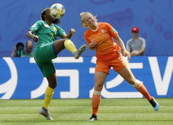 Cameroon's Ajara Nchout, ,left, and Netherlands' Kika Van Es, right, challenge for the ball during the Women's World Cup Group E soccer match between the Netherlands and Cameroon at the Stade du Hainaut in Valenciennes, France, Saturday, June 15, 2019. (AP Photo/Michel Spingler)