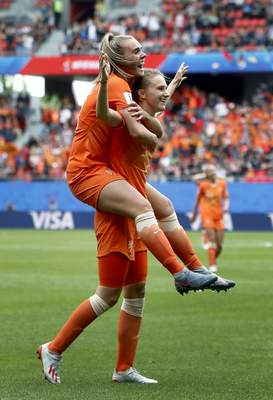 Netherlands' scorer Vivianne Miedema, right, and her teammate Netherlands' Jill Roord, left, celebrate their side's 3rd goal during the Women's World Cup Group E soccer match between the Netherlands and Cameroon at the Stade du Hainaut in Valenciennes, France, Saturday, June 15, 2019. The Netherlands defeated Cameroon by 3-1. (AP Photo/Michel Spingler)