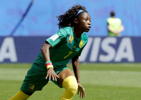 Cameroon's Gabrielle Aboudi Onguene celebrates after scoring her side's first goal during the Women's World Cup Group E soccer match between the Netherlands and Cameroon at the Stade du Hainaut in Valenciennes, France, Saturday, June 15, 2019. (AP Photo/Michel Spingler)