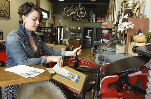 Michelle Davies | The Journal Gazette Julie Wall, owner of The Hedge print shop on Broadway, uses  a C&P printing press built in 1897.