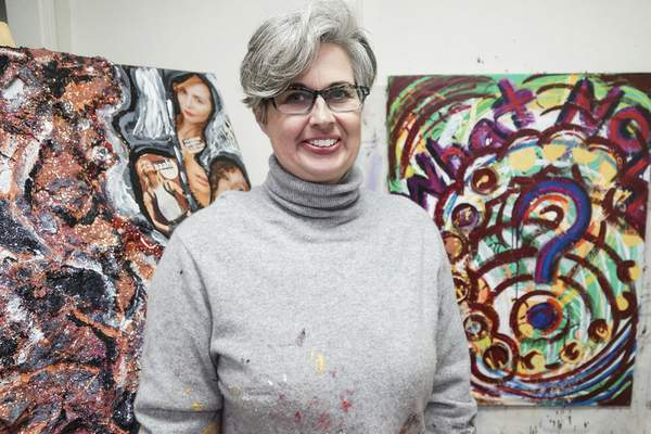 Mike Moore | The Journal Gazette Local artist Heather Miller posing for a photo in her studio at the Macedonian Tribune on Tuesday 05.21.19
