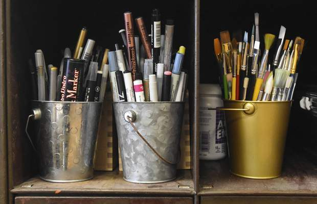 Michelle Davies | The Journal Gazette Buckets of various pens and brushes stored by Julie Wall, owner of The Hedge.