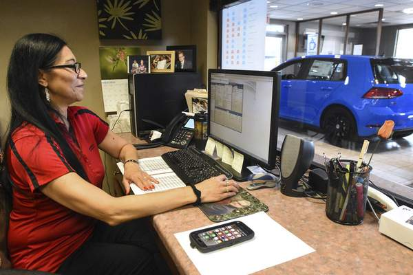 Michelle Davies | The Journal Gazette Caril Bernard, sales consultant with Vorderman Volkswagen, is a top internet salesperson for the company.