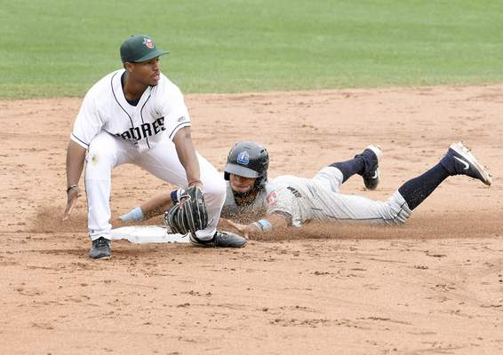 Photos by Rachel Von Stroup | The Journal Gazette TinCaps' Xavier Edwards takes the throw as Lake County's Jose Fermin slides safely into second during the third inning Sunday at Parkview Field.