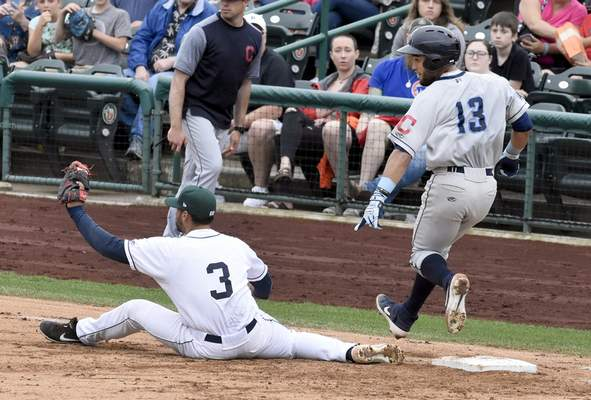 Rachel Von Stroup | The Journal Gazette TinCaps' Luis Roman catches the ball as the Captains' Jose Fermin points out that Roman's foot is off the bag during the third inning Sunday.