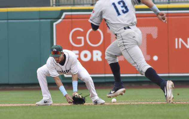 Rachel Von Stroup | The Journal Gazette  TinCaps' Tucupita Marcano misses a ground ball as the Captains' Jose Fermin races past him during the first inning at Parkview Field on Father's Day, Sunday June 16, 2019.