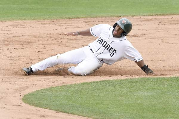 Rachel Von Stroup | The Journal Gazette  The TinCaps' Xavier Edwards slides into second base during the third inningof Fort Wayne's 4-3 win over Lake County on Sunday in the first-half season finale. Edwards singled and had a key walk in the game-winning ninth-inning rally.