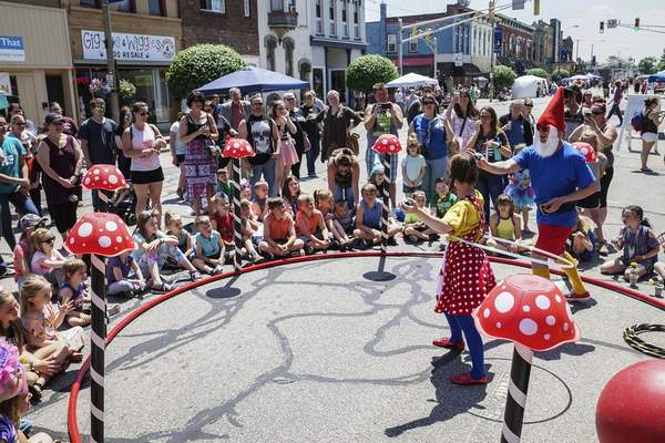 Mike Moore | The Journal Gazette The Striped Circus performers take part in the Fairy, Gnome and Troll Festival in May along Main Street in Kendallville.