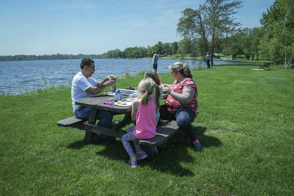 Mike Moore | The Journal Gazette  Stephen and Kathy Gomez from Oglespy, Texas spend the afternoon having a picknick with their grandchildren Kensley Davis, 7 and Riley Hanshoe, 5 at Bixler Lake in Kendalville, Indiana on Saturday 05.18.19