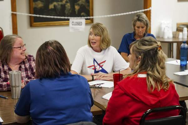 Michelle Mourey, center,  speaks during  a Blue Star Mothers meeting at VFW Post 857 on Main Street.